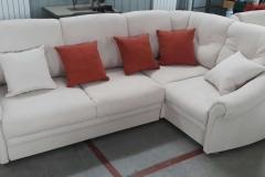 Перетяжка и ремонт углового дивана в мастерской